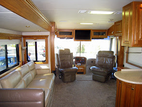 Photo: Front cockpit and sofa in main living area.