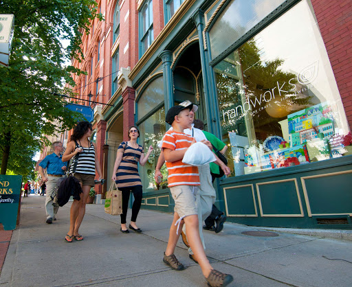 A family goes shopping for household goods and mementoes at stores in uptown Saint John, Canada.