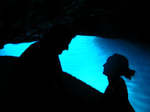 Photo: Mick and Emma lit by the glowing blue cave, Bisevo Island