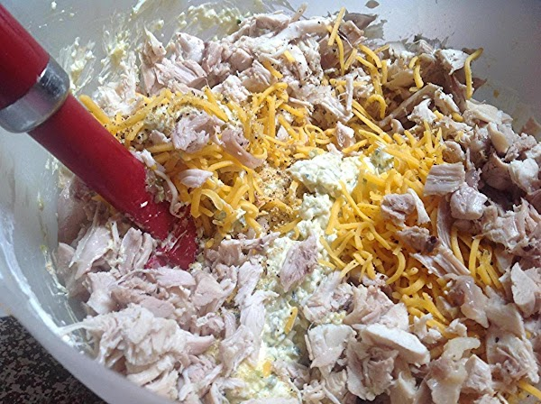 Add 1 cup of shredded cheese to cooked pepper mixture, then add in shredded...