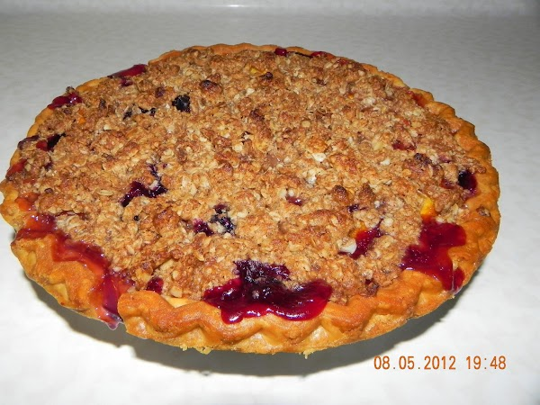 Remove pie from oven and let cool completely...if possible.  We couldn't wait and...