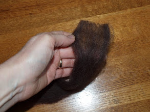 Photo: Pull the fibers apart, to make it even fluffier.  (It's a 2 handed job but my other hand is taking pictures.)  This will help it absorb water so it will be easier to felt.