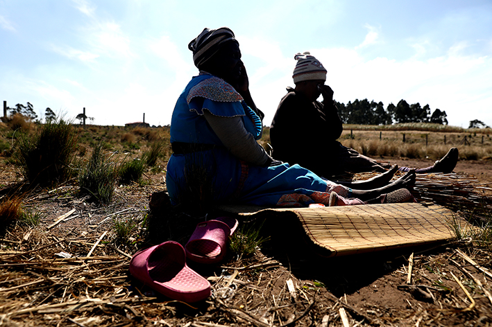 The mother of Mduduzi Mafutha Khomo and her niece outside their home in Mtwalume.
