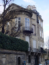Photo: We tour the Ile St.-Louis, the smaller of the two islands in the Seine, where the city was founded. Most of the great homes are from the 17th century under the designs of Louis le Vau, whose works included the Louvre and Versailles. The first house on the Quai D'Anjou (only three streets run the island's length) is the Hotel Lambert, with its unusual circular turret. Voltaire lived here when the building was owned by his mistress.