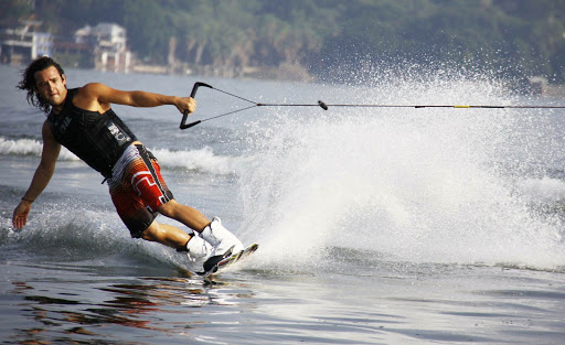 If you're game, try the sport of wakeboarding and perform some acrobatic maneuvers while trailing a speedboat.