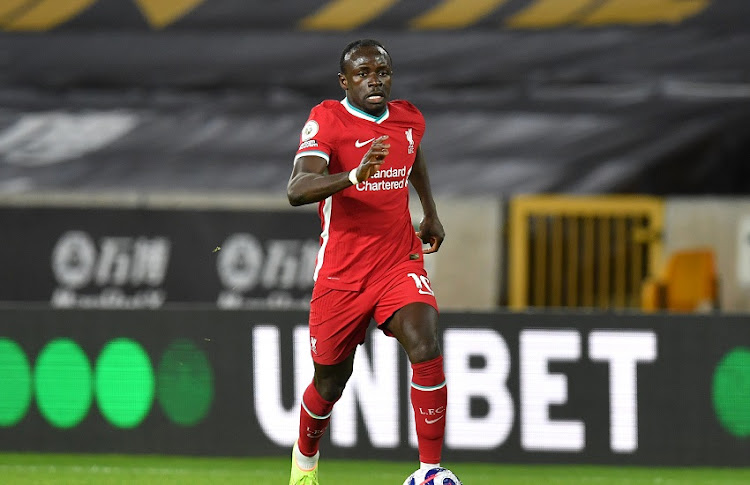 Sadio Mane of Liverpool runs with the ball during the Premier League match between Wolverhampton Wanderers and Liverpool at Molineux on March 15, 2021 in Wolverhampton, England.
