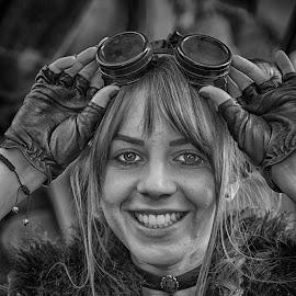 Joie De Vivre by Marco Bertamé - Black & White Portraits & People ( woman, hands, joie de vivre, young, girl, portrait, eyes, smile, glowes, goggles, headshot, teeth, big smile )