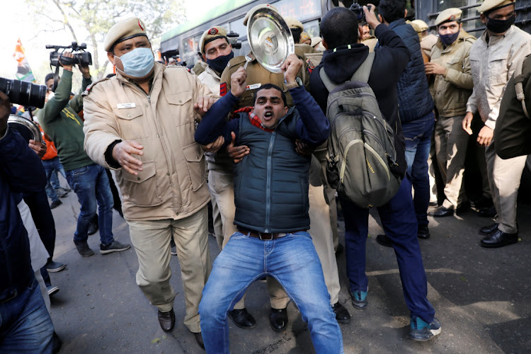 Police officers detain an activist during a protest against new farm laws in New Delhi, India, January 12 2021. Picture:REUTERS/ADNAN ABIDI