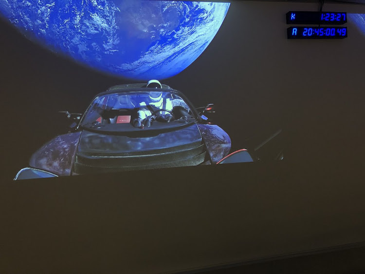 Starman in his cherry-red Tesla roadster in orbit over Australia.