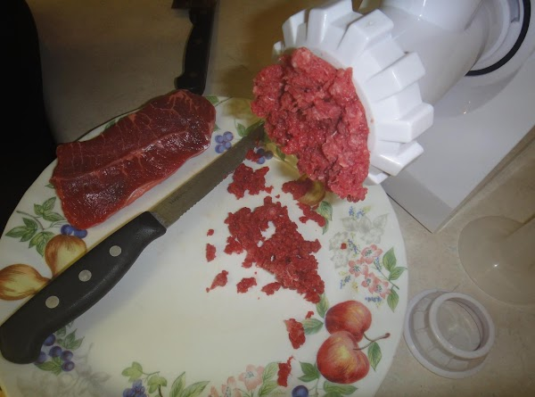 Grind your sirloin in a meat grinder. You can buy it already in a...