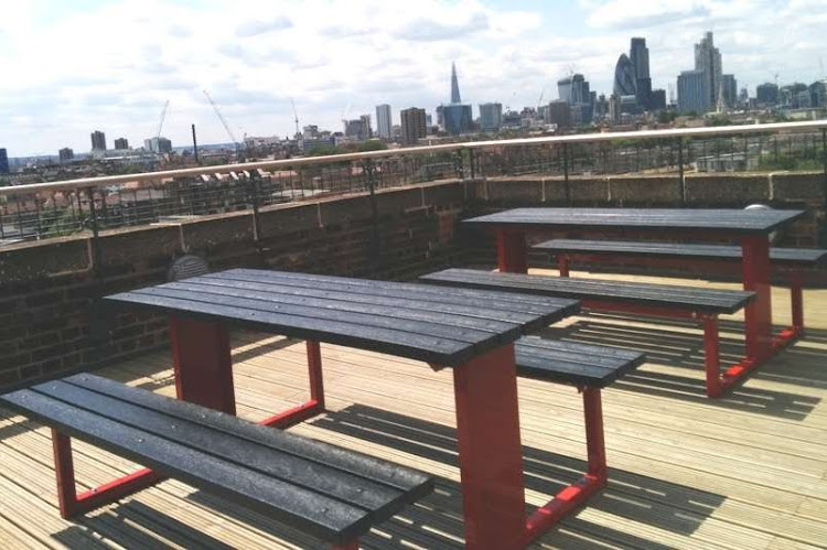 Black Recycled Plastic with Red Steel Framed Tables on decked roof terrace.