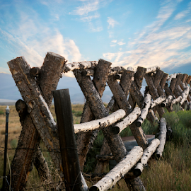 Fence to no where 100218 by Anthony Balzarini - Artistic Objects Other Objects ( #naturephotography, #bluesky, #mountain, #longfence, #farmfence,  )