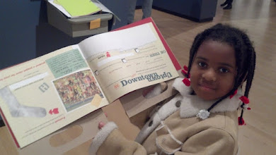 Photo: Kaleya shows off her museum provided Explorers book - very well done on behalf of the museum!