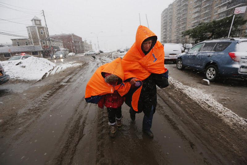 Photo: NEW YORK, NY - NOVEMBER 07:  Fatima Quentiro walks with her granddaughter Galalea Castro through the snow to a bus stop to take a bus to Quenitro's home after Castro's home was damaged by flooding as a Nor'Easter approaches in the Rockaway neighborhood on November 7, 2012 in the Queens borough of New York City. The two are wearing jackets donated by the NYC Marathon. The Rockaway Peninsula was especially hard hit by Superstorm Sandy and some are evacuating ahead of the coming storm.  (Photo by Mario Tama/Getty Images)
