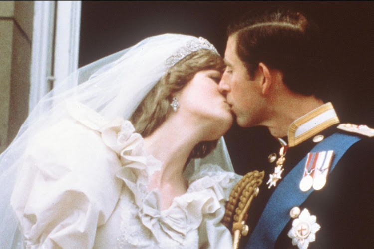 Charles, Prince of Wales, kisses his bride, Lady Diana, on the balcony of Buckingham Palace when they appeared before a huge crowd, on July 29, 1981, after their wedding in St Paul's Cathedral