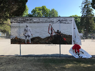<p> July 11. Red ribbon added temporarily by the artists/curator to send a public message that the banner is actively being cared for and will not be removed.&nbsp;</p>