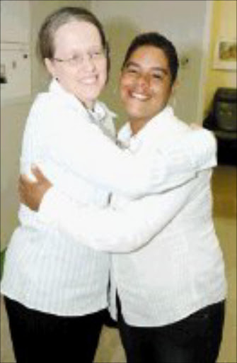 RECOGNITION: Dr. Kathy van der Donk embraces Sandy Booysens after she presented the doctor with a thank you gift for operating on her child. Pic. Mabuti Kali. 03/05/2007. © Sunday World.