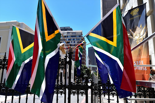 South African flags hanging outside Parliament in Cape Town ahead of the 2017 State of the Nation address. File photo.