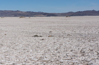 Photo: Dry lake bed covered with mineral deposits.