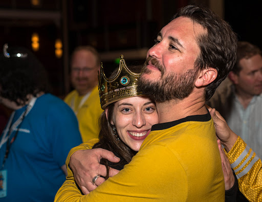 Actor Wil Wheaton hugs a Monarch of the Seas during the 2014 JoCo Cruise.