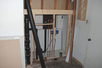Photo: Laundry room under construction - washer/dryer nook.