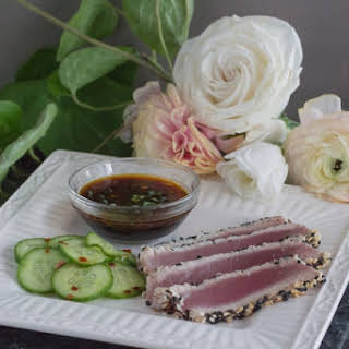 Sesame Crusted Ahi Tuna Steaks with Pickled Cucumbers.