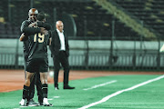 Coach Pitso Mosimane embraces goalscorer Mohamed Magdi in Ahly's 2-0 Caf Champions League semfinal first leg win against Wydad Casablanca at Stade V Mohamed in Casablanca, Morocco, on Saturday, October 17 2020.