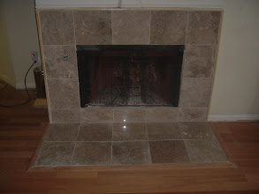 Photo: marble tile fireplace.