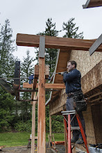 Photo: We first layed out the beams on the saw horses, and drilled them out, then clamped them to the post.  Then we drilled from each side to make a straight hole.