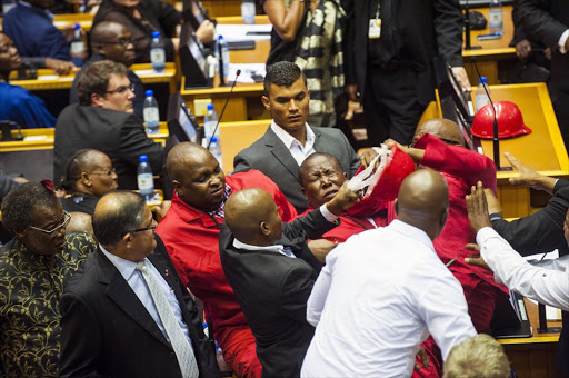 """We have seen that we are part of a police state."" — Julius Malema, after white shirts forced him and other EFF MPs out of parliament during the state of the nation address, February 12. File photo."