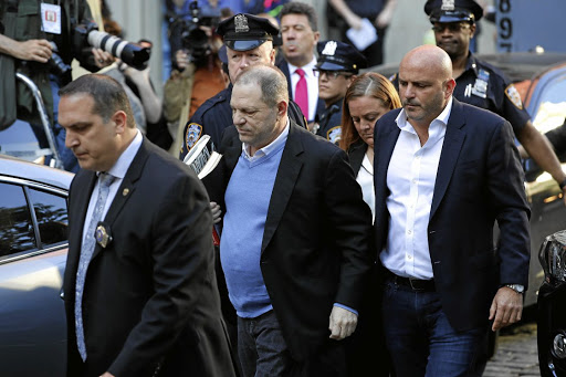 Film producer Harvey Weinstein, centre, arrives at the 1st Precinct police station in Manhattan, New York, on May 25 2018. Picture: REUTERS