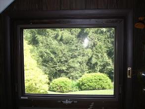 Photo: Vinyl woodgrain awning style window