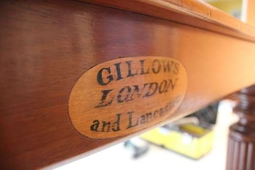 a wooden table with gillows london and lancaster written on it