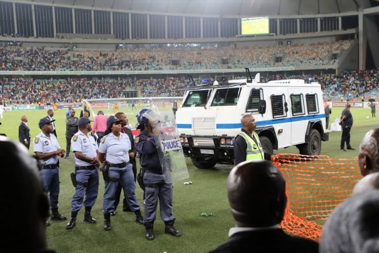 Violence erupted at the Moses Mabhida Stadium in Durban as angry Kaizer Chiefs fans stormed the pitch and attacked Premier Soccer League security personnel and destroyed after property after Steve Komphela's side bombed out of the Nedbank Cup following a 2-0 defeat at the hands of Free State Stars on Saturday April 21 2018. The Nedbank was the only available chance for Chiefs to end a barren three years without winning silverware.