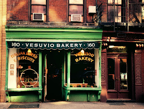 """Photo: """"Authentrification...""""  Vesuvio Bakery - Soho, New York City.  This is one of my favorite storefronts in Soho. A little over 90 years old, Vesuvio Bakery still looks as it did for decades. A tiny bit about the original owners of the bakery is found in a newspaper article from 2003 :  """"Dapolito, 83, worked as a boy in the bakery on Prince St., decades before the neighborhood came to be known as Soho. His father and mother, Nunzio and Jennie, immigrants from Naples, opened it in 1920 and Tony went on to own it after they died.""""  What is interesting about this beautiful old bakery storefront is that the bakery is no longer in the Dapolito family and has changed ownership several times since the article cited above was written. However, it is currently still operating as a bakery and the owners have kept the storefront intact.  In early October, an article was making the rounds on local lower Manhattan blogs about a recent trend that involves new shop owners paying homage to the history of a neighborhood via their store facades. The article is called: In Which We Mark Graves Like Birthplaces (you can view it here: http://thisrecording.com/today/2011/10/3/in-which-we-mark-graves-like-birthplaces.html ). It calls this process """"authentrification"""", a term I really love but a term that definitely stirs up conflict. This process of authentrification has been happening quite a bit on the Bowery and in the East Village but the article does cite Vesuvio Bakery as being an example of this process as well. Part of me is thrilled that new businesses are looking to capture the feel of a neigborhood by zeroing in on feelings of nostalgia related to older versions of New York City but part of me also feels that some of the authentrification that is going on is a bit hollow in overall intent.  My angst seems to be mostly directed at the authentrification taking place on the Bowery (especially with Daniel Bolud's high-priced restaurant DBGB whose storefront is modeled on the kitc"""