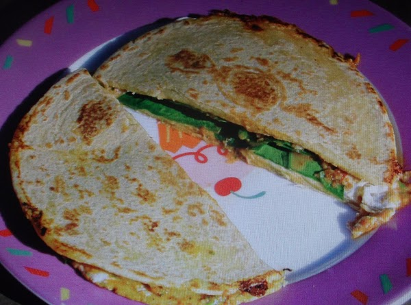 FOR QUICK LUNCH QUESADILLAS.  Place cheese and jalapeno peppers on each tortilla .Fold over...