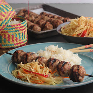 Laotian Grilled Pork Skewers With Papaya Salad And Sticky Rice.