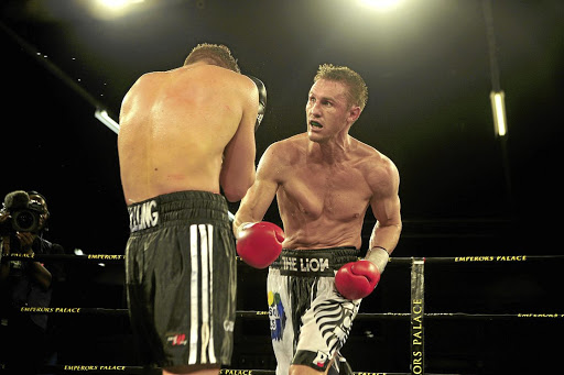 Ryno Liebenberg, right, in previous bout against Enrico Koelling, promises to go for the kill when he challenges for the IBF belt on February 17.