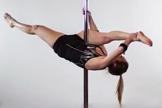 Photo: Vertical Pole Gymnastics - Arm Wrap Bow Split