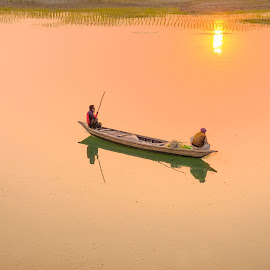 Fishing Boat At Sunset by Mamunur Rashid - Landscapes Waterscapes ( golden hour, fishing, sunset, man, fisherman, boat )