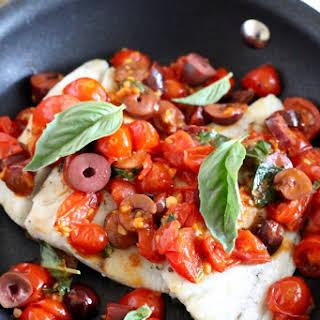 Barramundi in Tomato Basil White Wine Sauce.