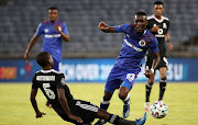 Moses Waiswa Ndhondhi of SuperSport United challenged by Ben Motshwari of Orlando Pirates during the DStv Premiership match between Orlando Pirates and SuperSport United at Orlando Stadium on November 21, 2020 in Johannesburg, South Africa.