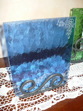 Foto: portafoto in vetro e struttura portante in ferro