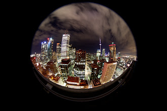 Photo: With the influx of street photographer followers recently, I thought it would be appropriate to introduce everyone to my real love...rooftopping (see some of my other past rooftopping albums).  I got the chance to test the new Canon 8-15mm fisheye lens recently (thanks +Ronnie Yip). This is the circular fisheye image you will get at 8mm on a full frame full frame sensor. The lens actually begins to vingette at 14mm on a 5d mk ii, so the usage is rather limited on a full frame. On a crop body, there's a lot more flexibility. 15mm on a crop will show a bit of distortion, while it begins to vingette at 10mm. In my opinion, this lens is a winner on a crop, but limiting on a full frame (i.e. you may as well get the 15mm Fisheye at a fraction of the price).