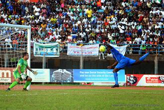 Photo: Alhassan 'Crespo' Kamara, heads the ball past the Tunisian Keeper to make it 2:1 to the Leone Stars [June 2013 (Pic: Darren McKinstry)]