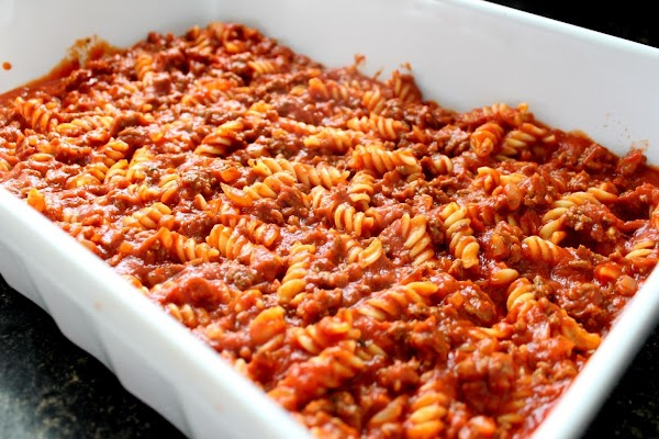 Rotini pasta and ground beef in a baking dish.