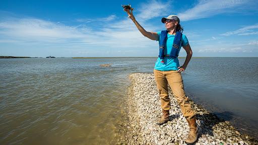 Julie Sullivan, coastal restoration project manager for the Nature Conservancy. © Jerod Foster for The Nature Conservancy.