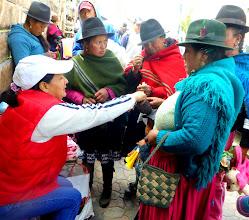 Photo: Vendor (in baseball cap) with Cañari customers