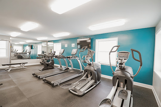 Fitness center with treadmills and weight machines