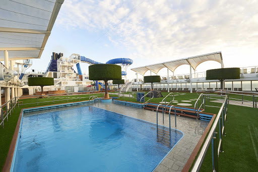 Chill by the pool at Serenity Park aboard Norwegian Joy.